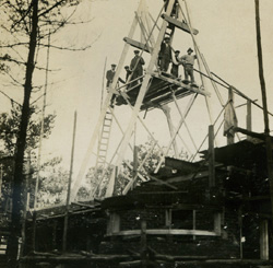 Construction photograph, 7 Oct. 1924, positioning of trusses on the high roof.