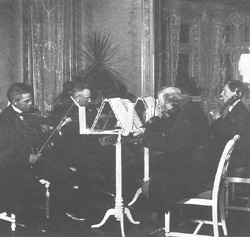 Carl Nielsen, Gerard von Brucken Fock, Julius Rontgen and his son Engelbert play string quartet at Fuglsang